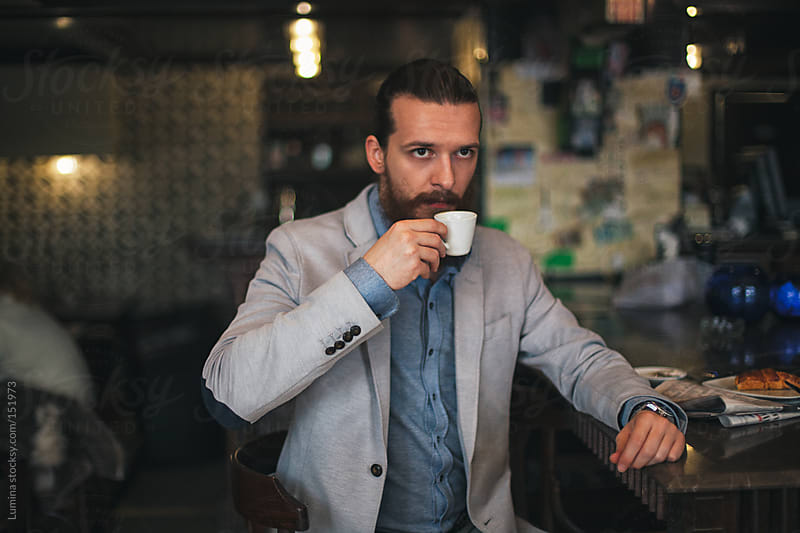 Man Drinking Espresso at a Cafe by Lumina for Stocksy United