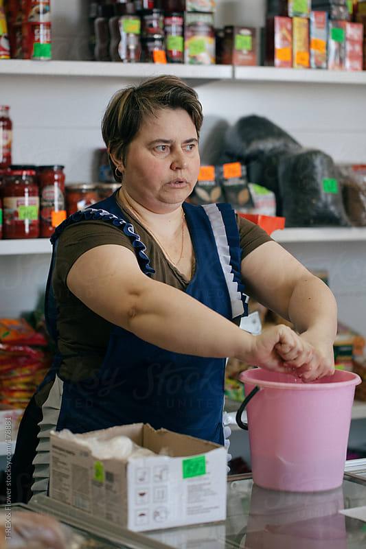 seller of shop by Danil Nevsky for Stocksy United