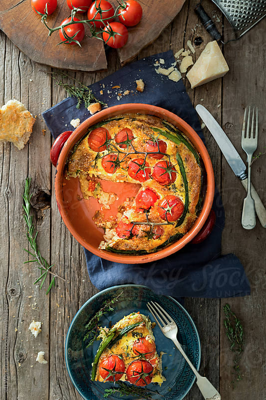 Overhead View of Frittata with Vine Tomatoes and Asparagus  by Jeff Wasserman for Stocksy United