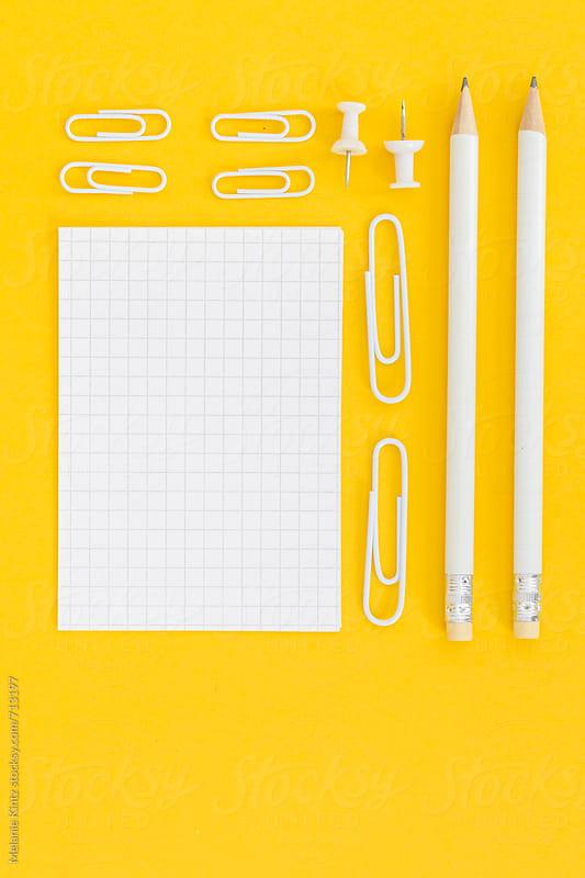 White office utensils on yellow background by Melanie Kintz for Stocksy United