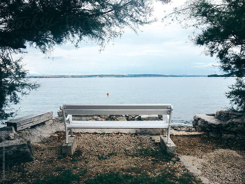 Bench on the shore by Davide Illini for Stocksy United