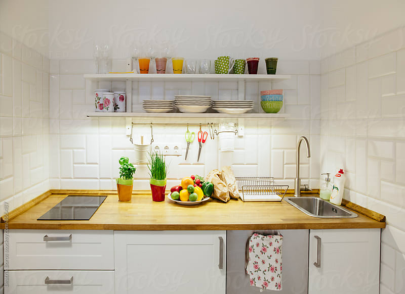 Small kitchen with healthy food on the counter by Beatrix Boros for Stocksy United