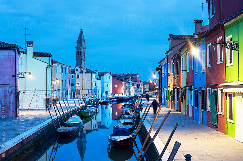 Colorful street with a canal in Burano at blue hour by Bisual Studio for Stocksy United