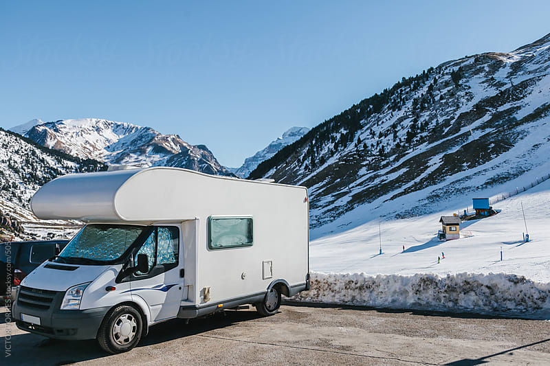 Camper Parked in a Ski Resort by VICTOR TORRES for Stocksy United