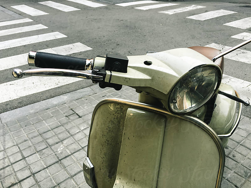 Closeup of an old scooter on the street. by BONNINSTUDIO for Stocksy United