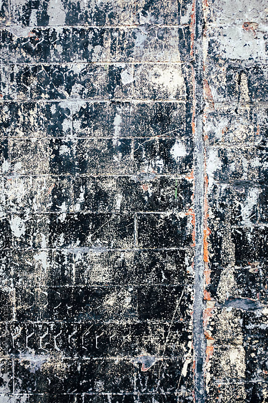 Close up old and dirty brick wall by Paul Edmondson for Stocksy United