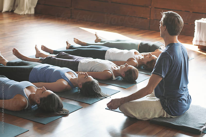 Male Yoga Teacher With Female Students by VISUALSPECTRUM for Stocksy United