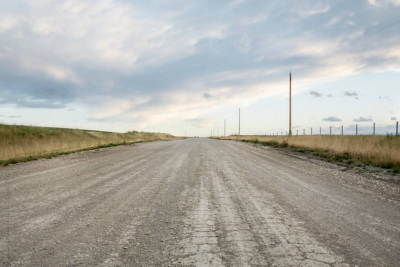 a gravel road in the country with a big sky by Shaun Robinson for Stocksy United