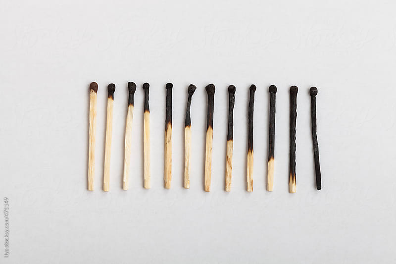 Matches forming sequence on slightly gray background by Ilya for Stocksy United