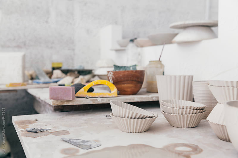Ceramic bowls drying in a studio by Lior + Lone for Stocksy United