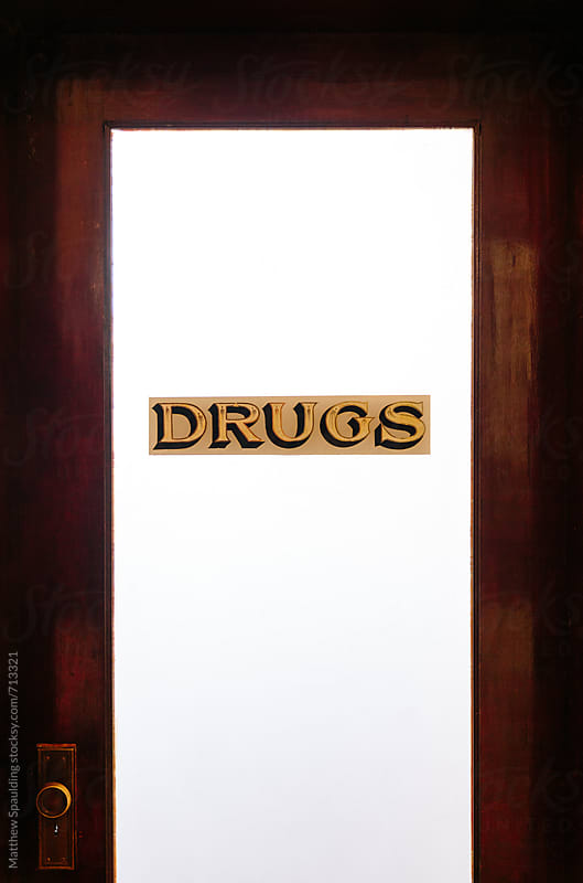 Drug sign on antique pharmacy door by Matthew Spaulding for Stocksy United