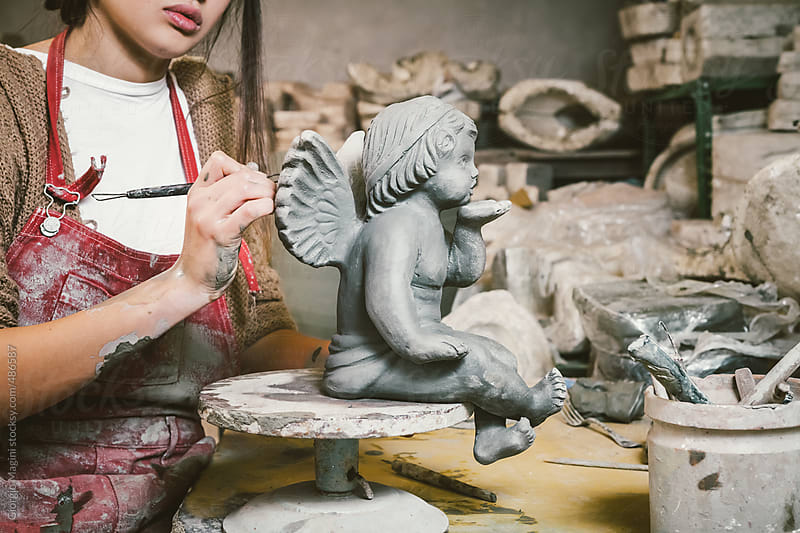Young Artist Creating a Statue of an Angel with Ceramics by Giorgio Magini for Stocksy United