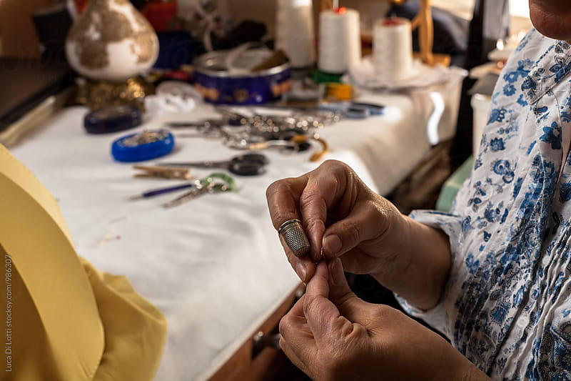 Italian Artisan at Work in her Workshop by Luca Di Lotti for Stocksy United