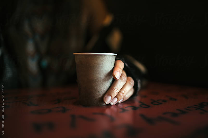 Hand Holding a Take Away Coffee Cup by VICTOR TORRES for Stocksy United