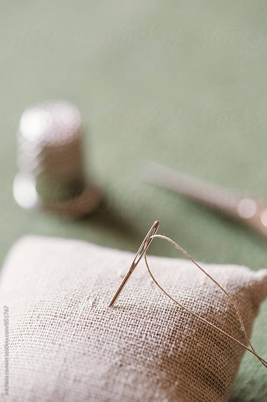 Needle with thread by michela ravasio for Stocksy United