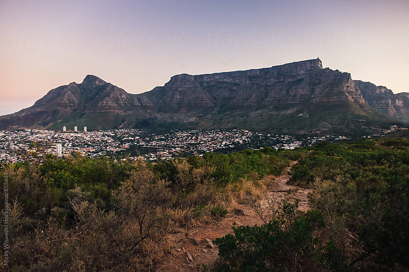 A mountain path with Cape Town city and Table Mountain in the background by Micky Wiswedel for Stocksy United