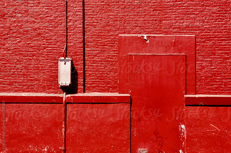 red brick wall and door background by Sonja Lekovic for Stocksy United