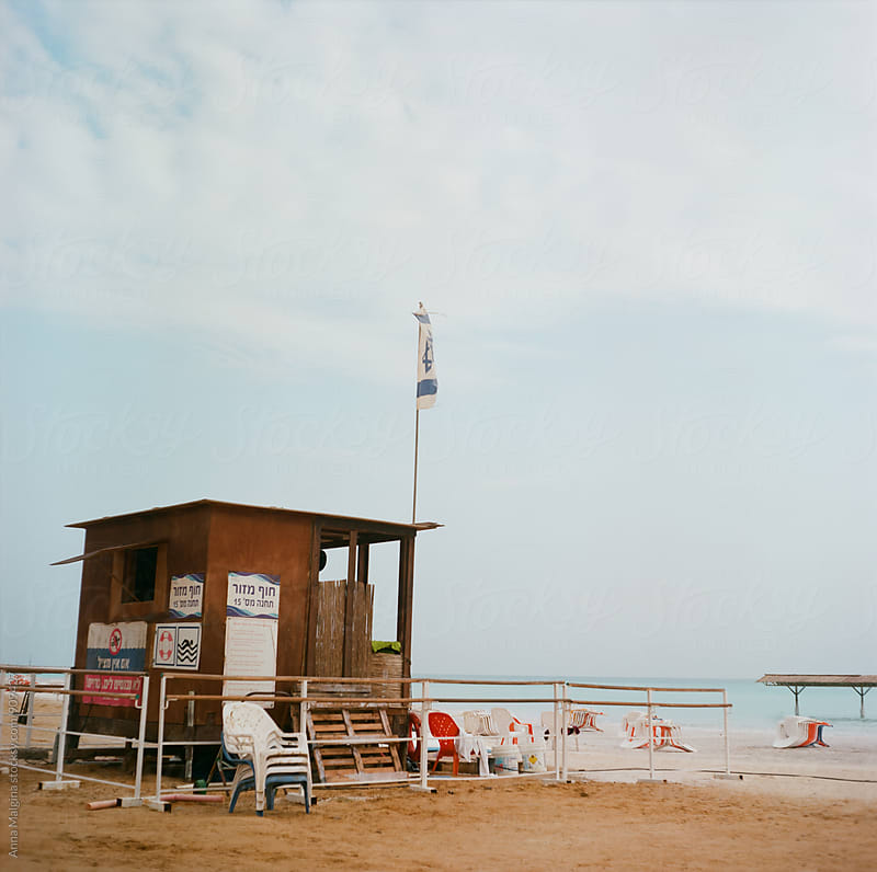 A film photo of seashore on dead sea by Anna Malgina for Stocksy United