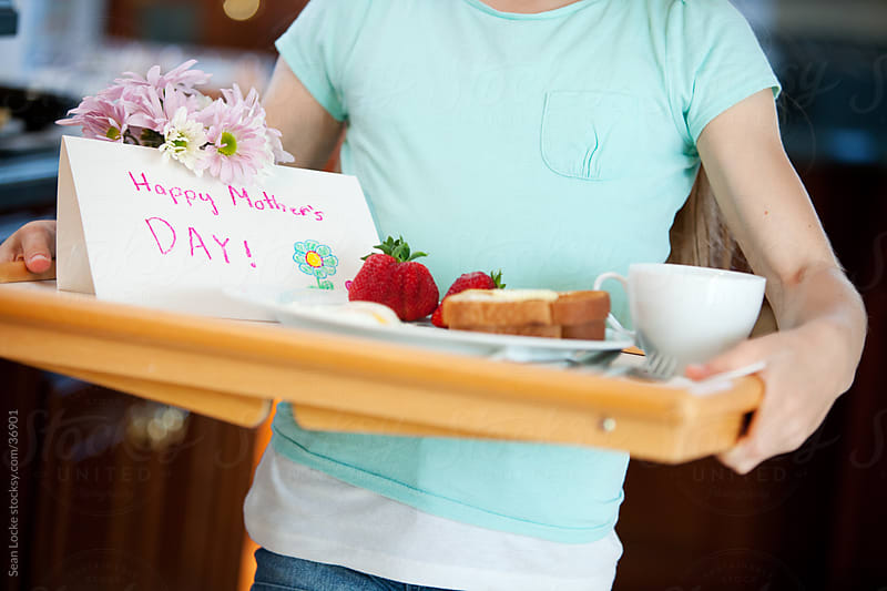 Mother's Day: Girl Carrying Tray with Breakfast For Mom by Sean Locke for Stocksy United
