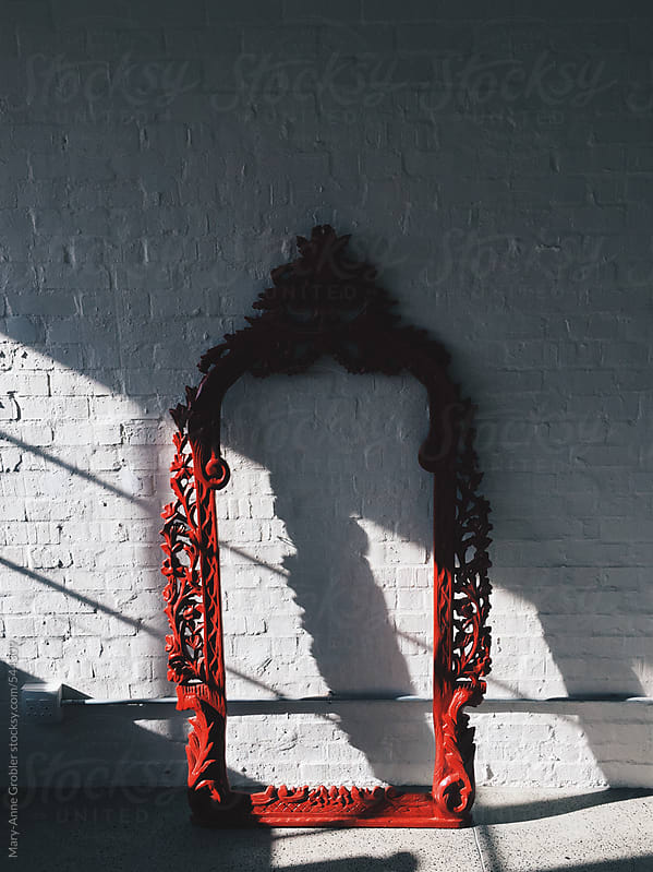 Red frame by Mary-Anne Grobler for Stocksy United