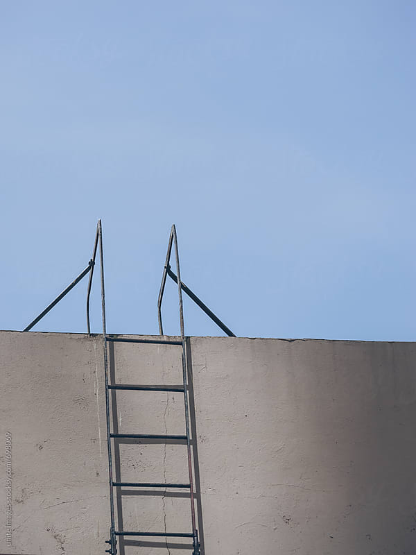 The ladder leading to the roof of a modern building by unite images for Stocksy United