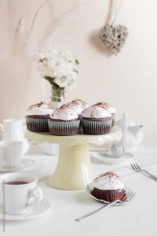 Chocolate cupcakes with creamy frosting by Nataša Mandić for Stocksy United