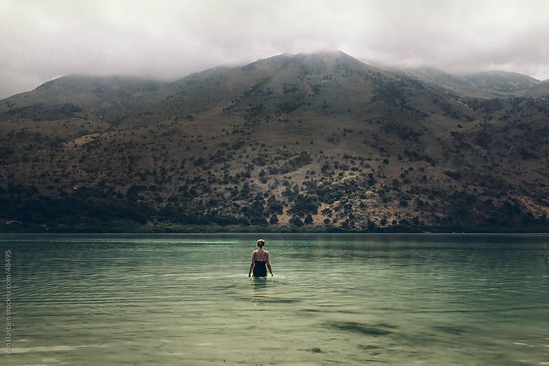 Lonely woman bathing in a mountain lake in Crete (Greece) by Ivan Bastien for Stocksy United