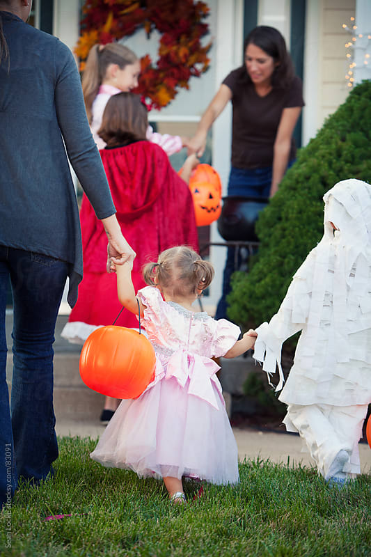 Halloween: Mother Taking Kids Trick-Or-Treating by Sean Locke for Stocksy United