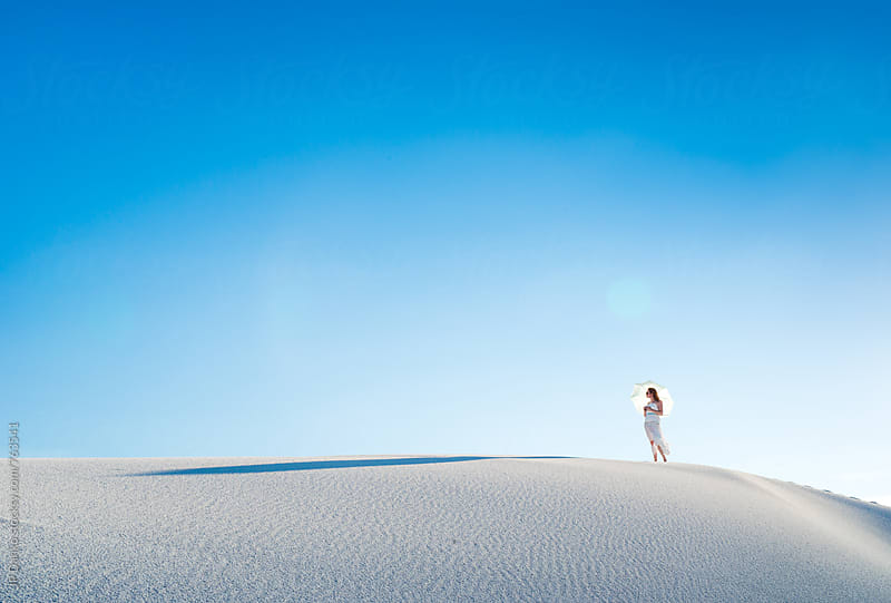 Woman on Sand Dune with Sun Umbrella In White Sands National Monumant New Mexico & Vibrant Blue Sky by JP Danko for Stocksy United