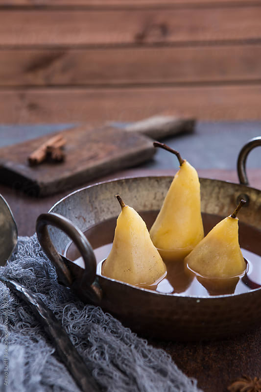 Poached pears in a bowl by Aniko Lueff Takacs for Stocksy United