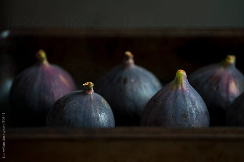 fresh ripe purple figs arranged for baking by Lee Avison for Stocksy United