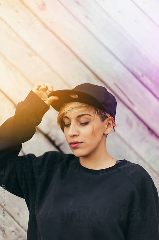 hipster woman with cap by Javier Pardina for Stocksy United