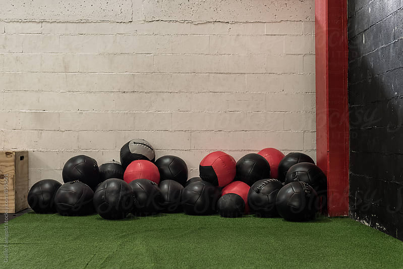 weighted balls in a  gym by Guille Faingold for Stocksy United