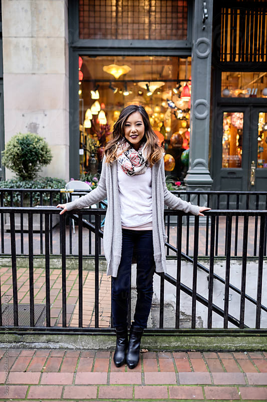 Beautiful Asian woman  in an urban area by Suprijono Suharjoto for Stocksy United