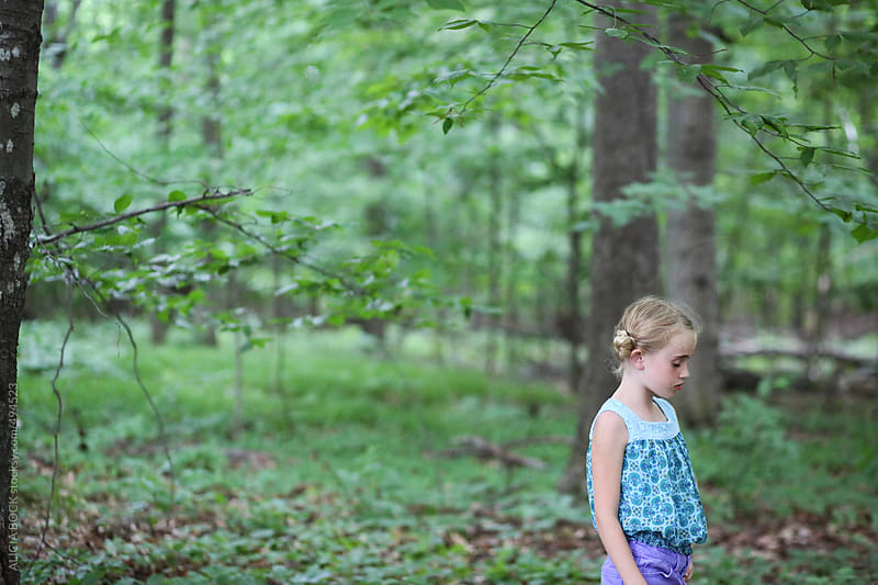 A Girl Looking Sad In A Spring Forest by ALICIA BOCK for Stocksy United