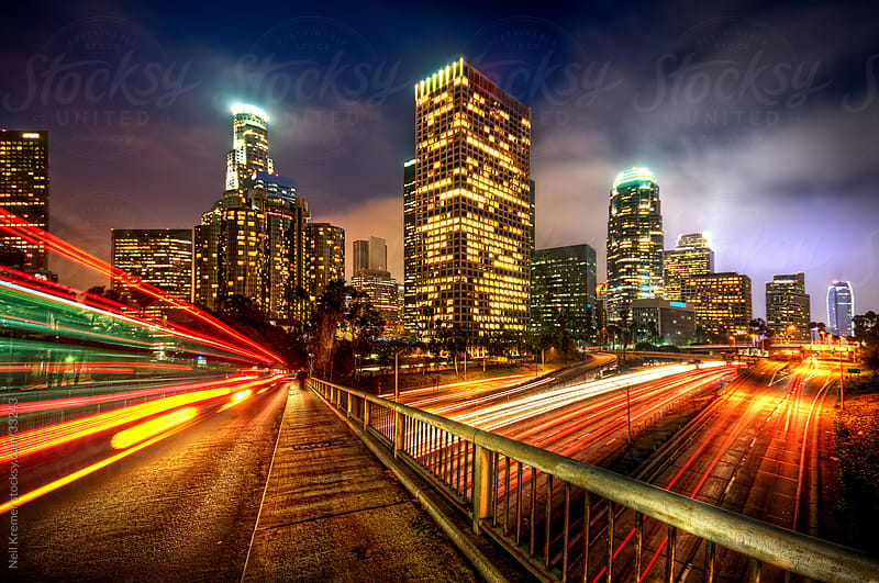 Cityscape at night of Los Angeles by Neil Kremer for Stocksy United