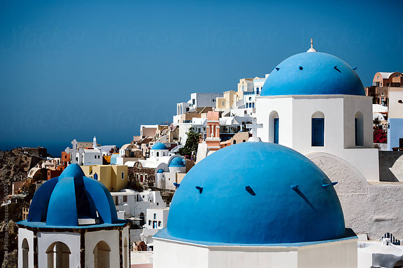 Blue domed churches, Santorini by Paul Phillips for Stocksy United