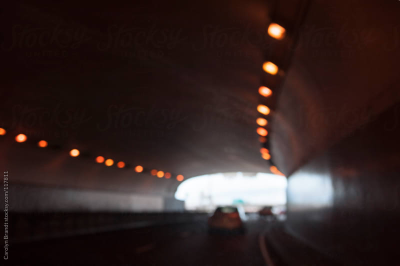 driving through a tunnel by Carolyn Brandt for Stocksy United