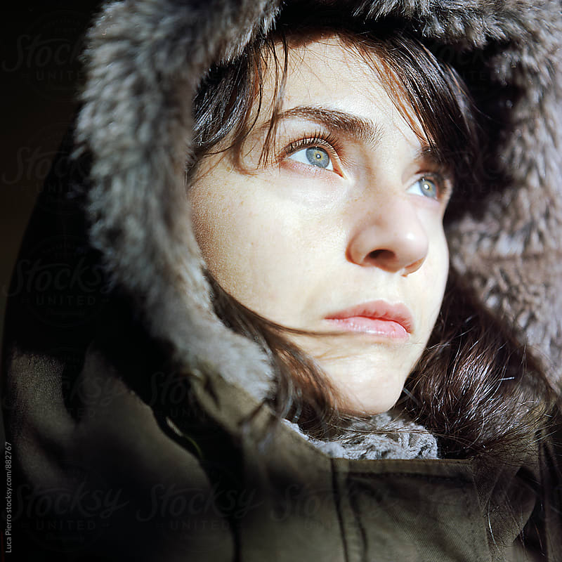 Closeup of a woman in a warm parka jacket by Luca Pierro for Stocksy United