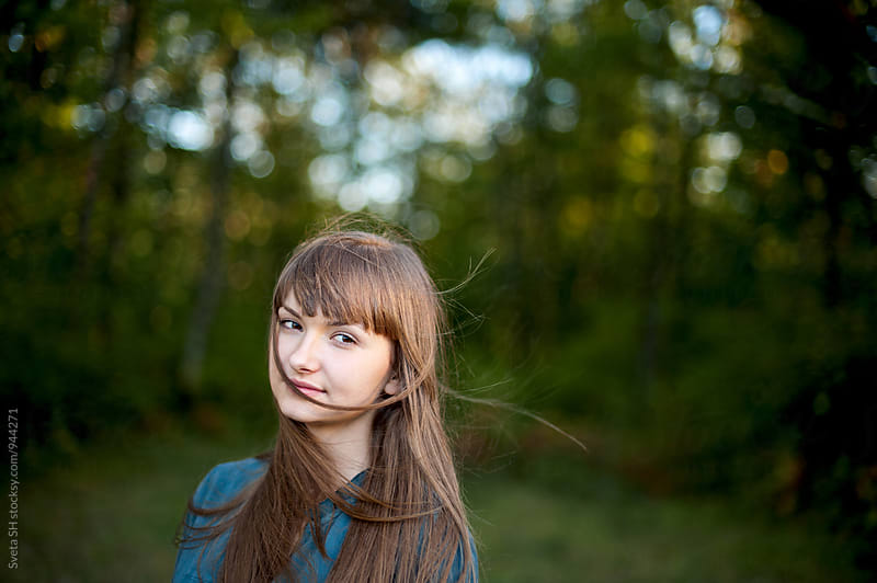 Portrait of a girl with dark brown hair by Svetlana Shchemeleva for Stocksy United