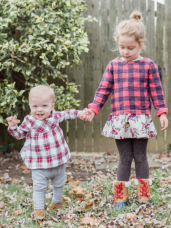 two little girl sisters  by Meaghan Curry for Stocksy United