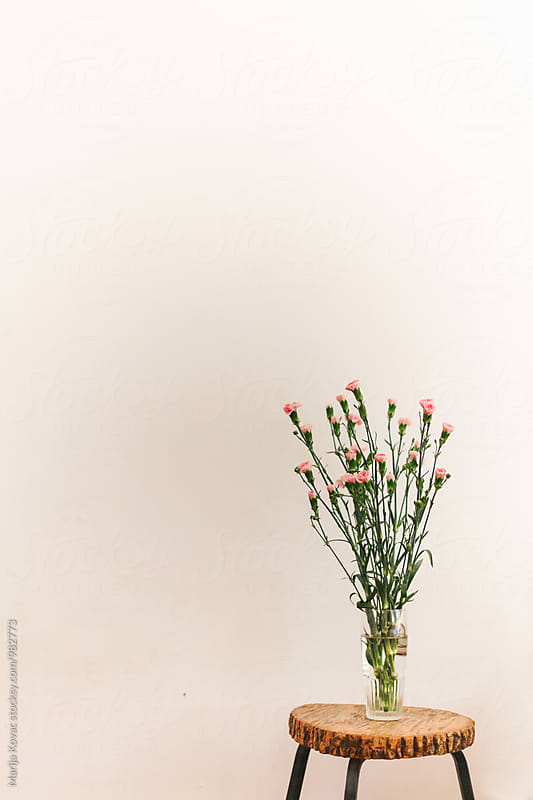 Bouquet of flowers on a wooden table by Marija Kovac for Stocksy United