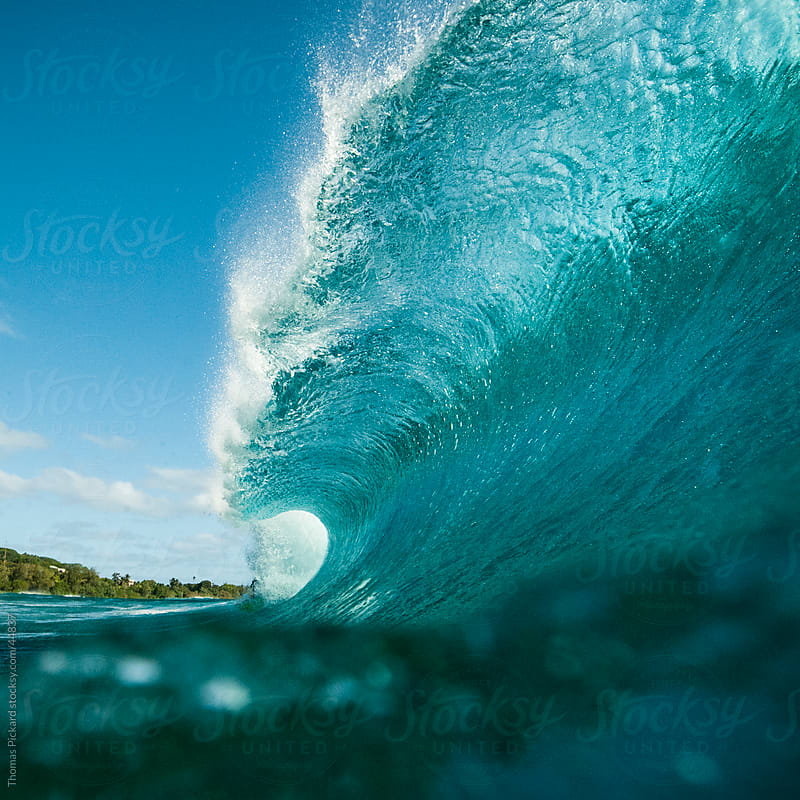 Wave breaking over reef, Rarotonga, Cook Islands. by Thomas Pickard for Stocksy United
