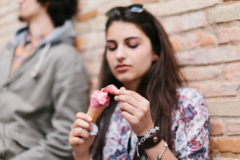 Handsome Teenager Girl Eating an Ice cream Cone by HEX. for Stocksy United
