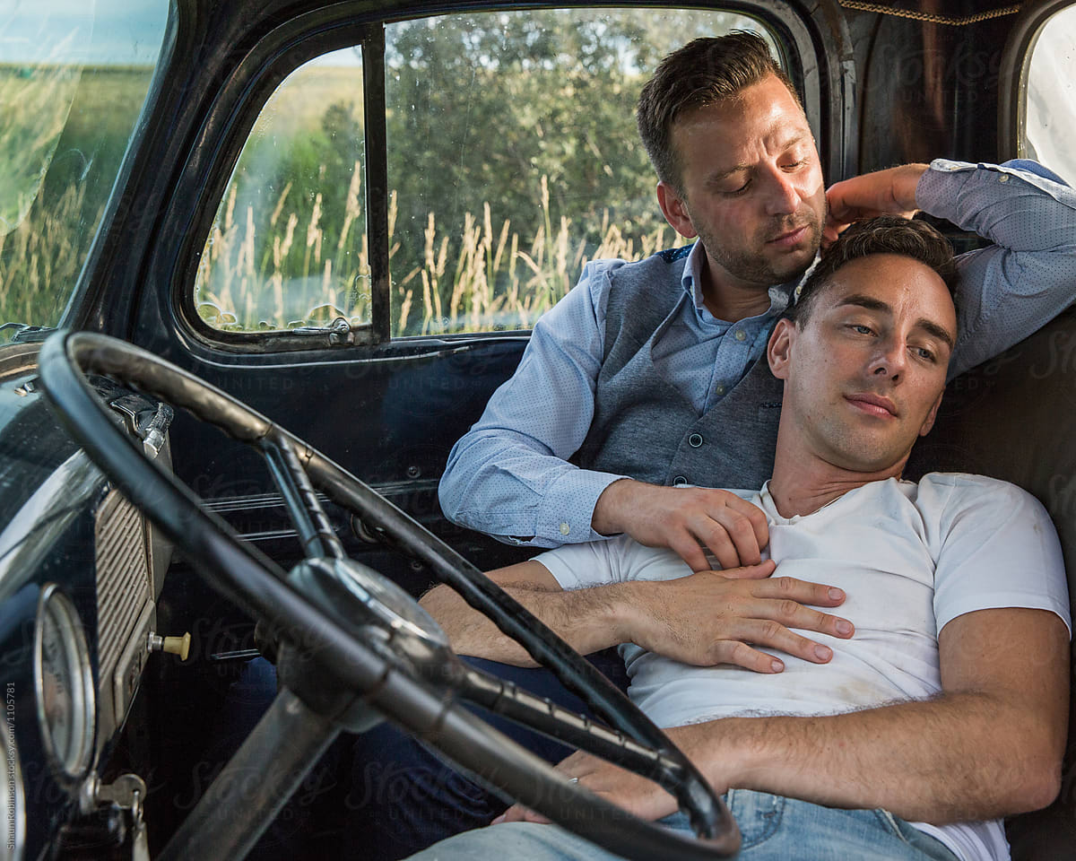 Gay Men Cuddling Romantically In Vehicle  Stocksy United-7547