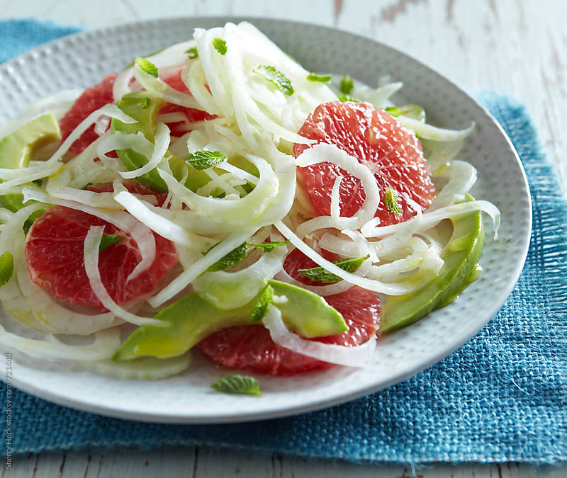 Salad of fennel, pick grapefruit, avocado with light dressing on white plate by Sherry Heck for Stocksy United