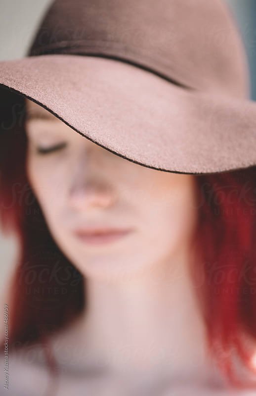 closeup of young dreaming woman with hat. by Alexey Kuzma for Stocksy United