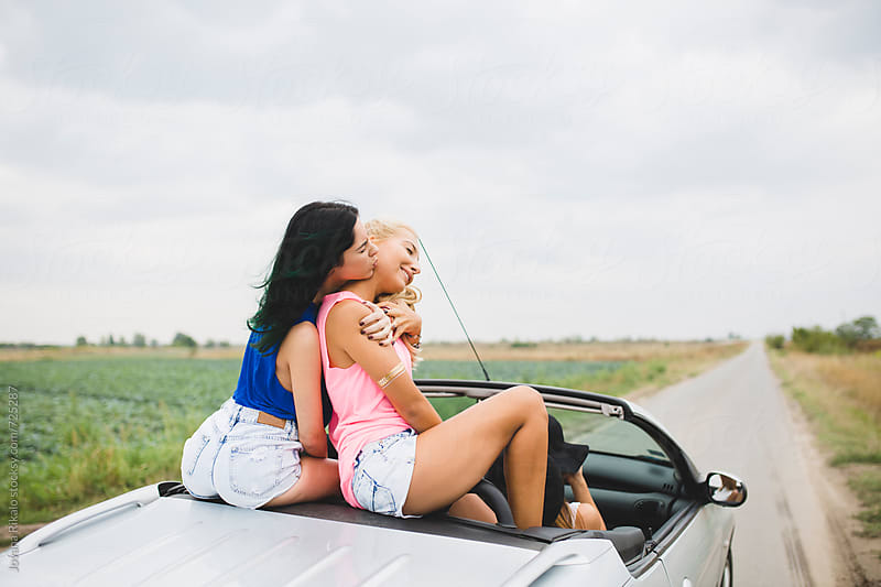 Female friends in cabriolet by Jovana Rikalo for Stocksy United