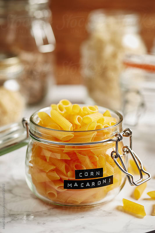 Close-up of corn macaroni in glass jar by Martí Sans for Stocksy United
