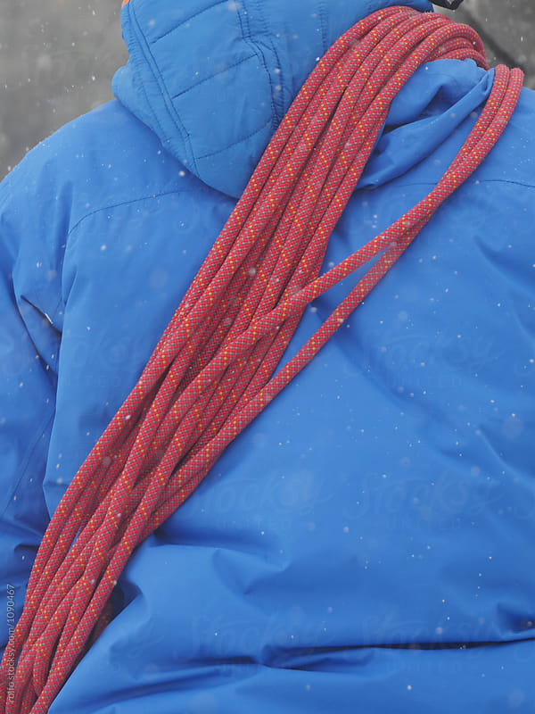 Man with bright alpinist's rope on back by rolfo for Stocksy United